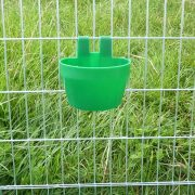Cage feeding or drinking cup in cage