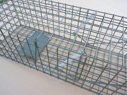 Double spring closing mechanism on PERDIX Mink cage trap