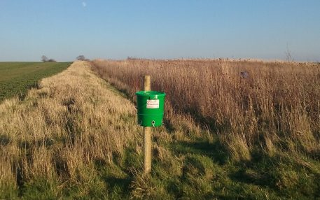 PERDIX Farmland Feeder next to wild bird habitat on farm