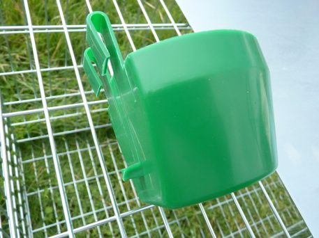 Cage feeding or drinking cup easily clips onto cage