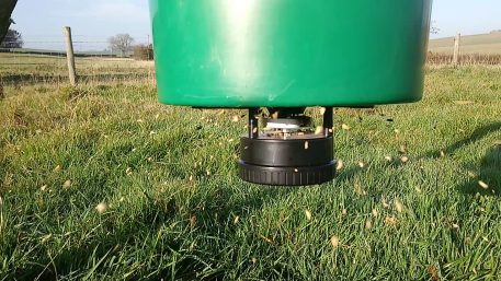 Farmland bird supplemental feed being automatically spread